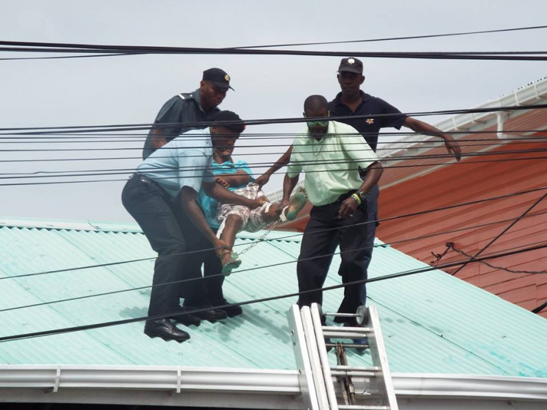 Police arrest alleged sodomy victim after roof top protest
