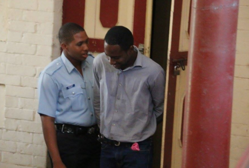 Police officer remanded to jail over unlicensed weapon and ammunition