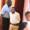 Security guard remanded to jail on attempted murder charges after shooting behind three men