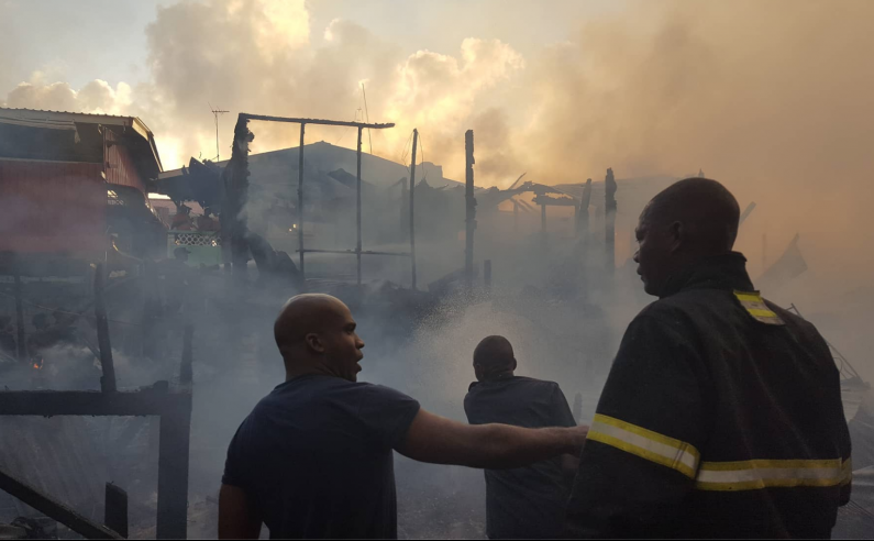 Arson suspected in early morning blaze that gutted three houses