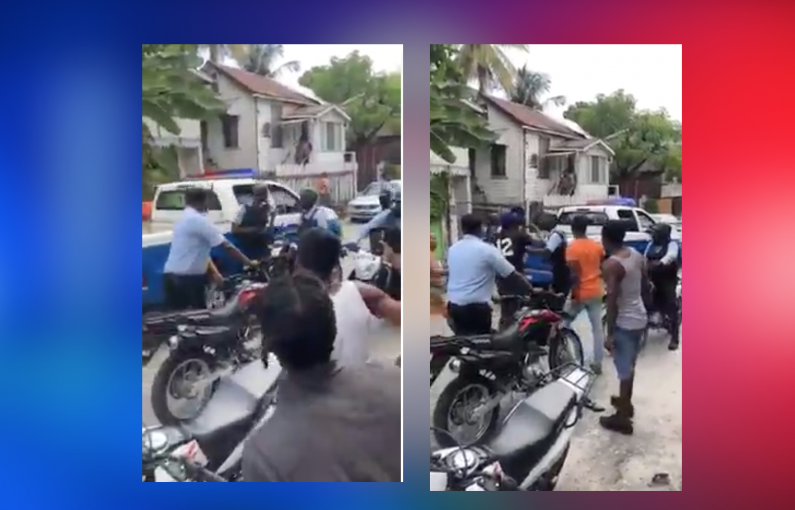 Police rank and robbery suspect shot by policeman's gun during arrest scuffle