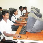 Secondary students at their school's ICT lab