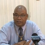 Minister in the Ministry of Finance Juan Edghill speaking to the media