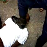 officers from the guyana police force stomps mans neck and kicks him to the head