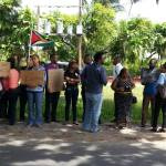 Group holds silent picket outside AG office over Crum-Ewing's murder