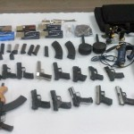 15 hand guns, 2 AK-47 rifles and ammunition found in barrel at city wharf