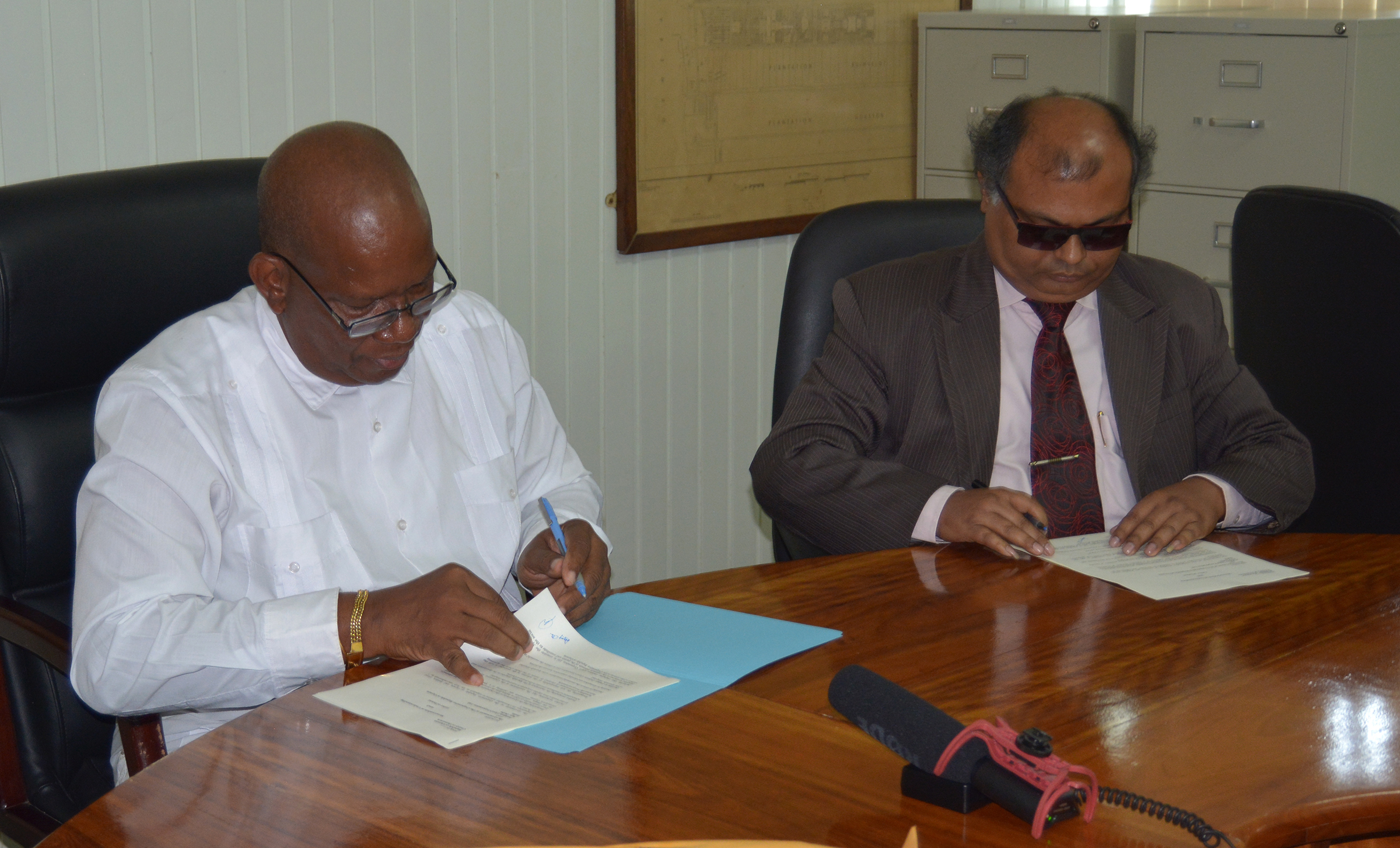 Finance Minister Winston Jordan signs MOU with Fedders Lloyd representative