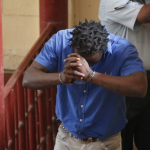 Taxi driver remanded on robbery and gun possession charges
