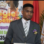 "Recently deported Trini fraudster ""returns"" and opens etiquette school in Guyana"