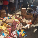 Piles of expired food items seized from Stabroek Market Bazaar during City Council raid