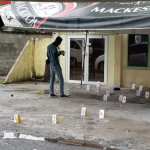 Man riddled to death outside Forshaw St. Hotel; Over 20 spent shells recovered