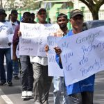 Sugar workers picket President's Office demanding raise of pay
